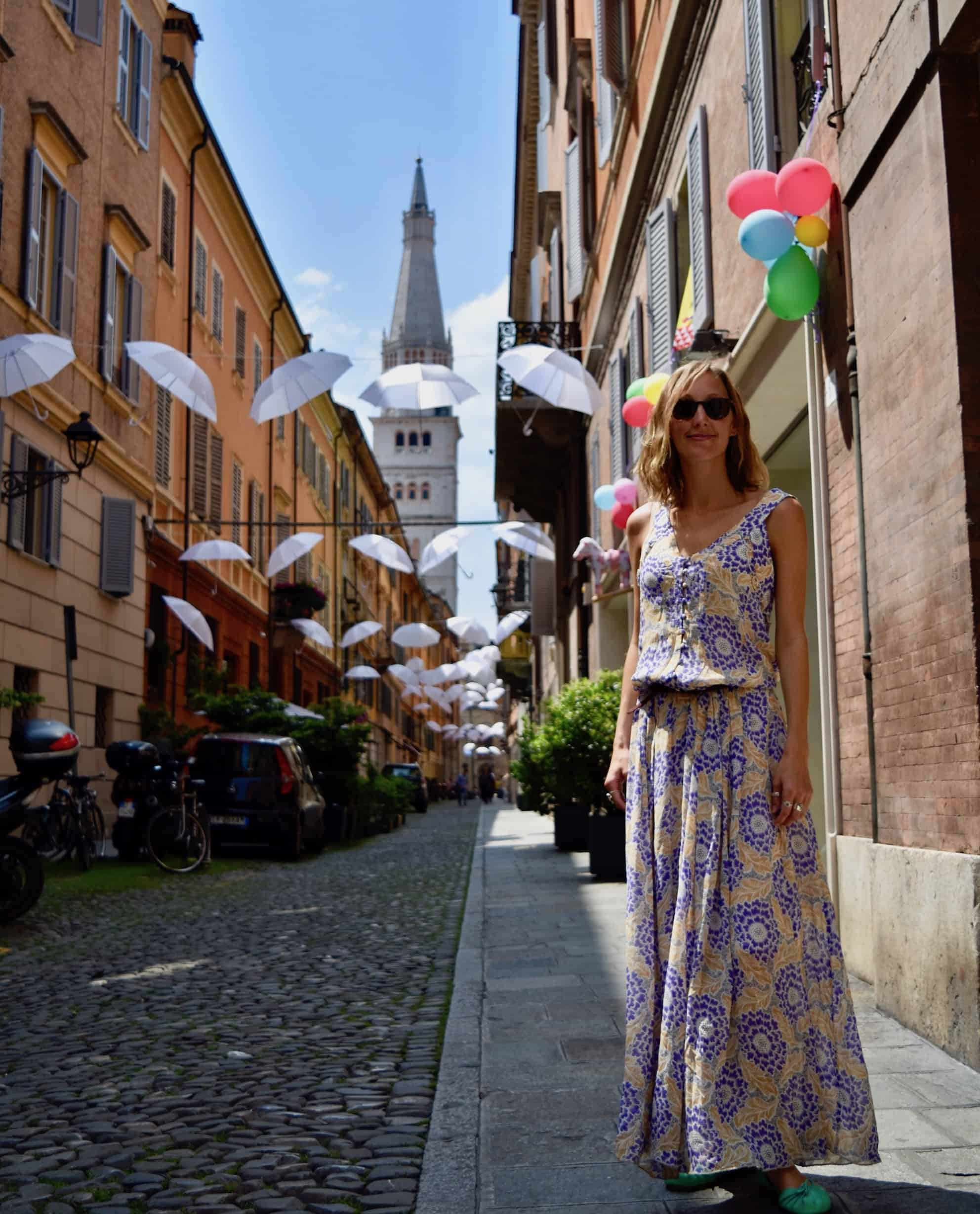 Hayley Lewis standing on a cobbled street in Modena, Emilia Romagna