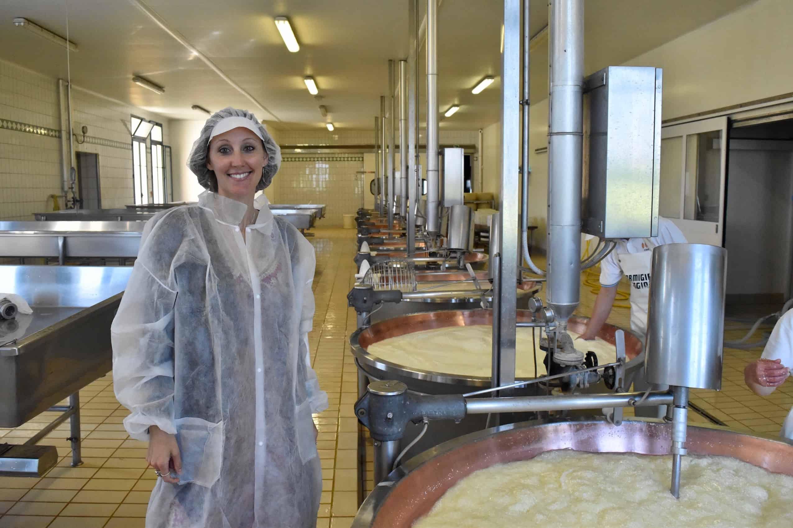 Huge vats of milk, part of the process of producing Parmigiano Reggiano